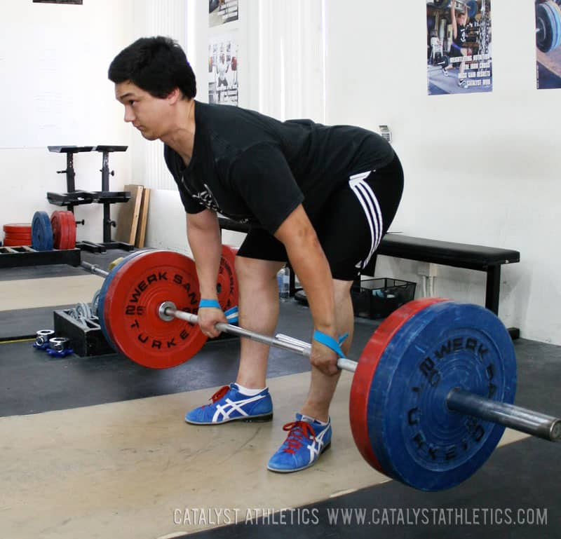 man dead lifting weights