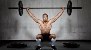 man deadlifting weights