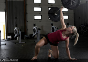 women weightlifting with one arm barbell