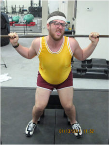 man having difficulty lifting weights