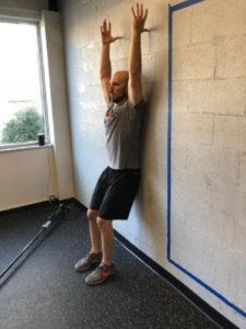Dr. Cohen demonstrating Back to Wall Shoulder flexion