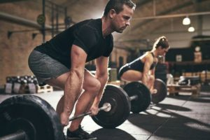 man and woman getting ready for a heavy deadlift