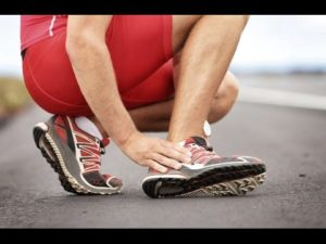 picture of a runner nursing a sprained ankle