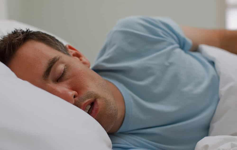 man sleeping on a pillow