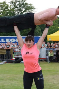 picture of woman weightlifting a man