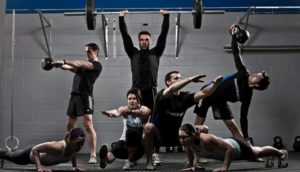 picture of multiple athletes doing various weight exercises