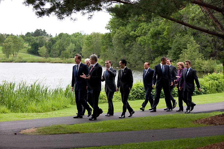 business people walking together on a path