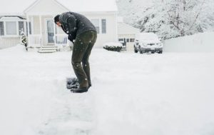 picture of man shoveling snow