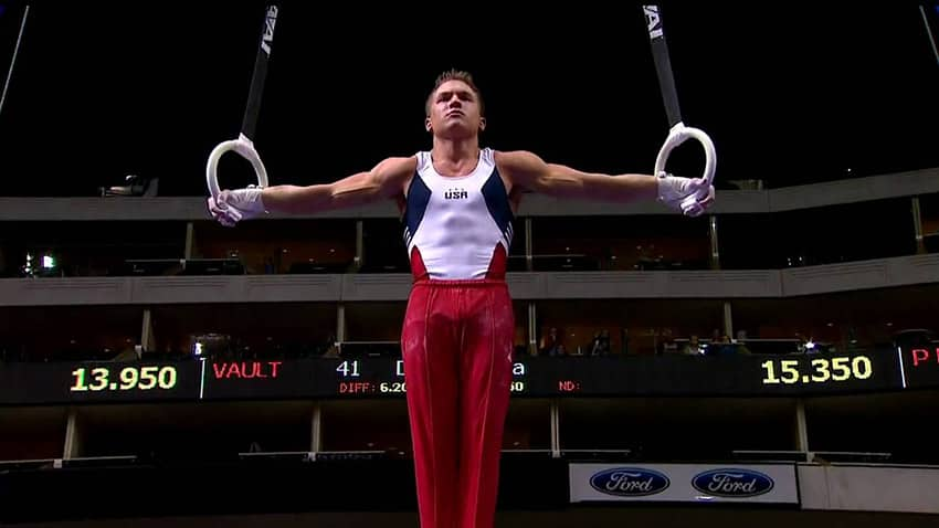 gymnast doing ring pullup