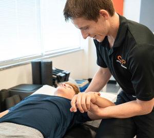 Dr. Alex Immerman assessing a patient