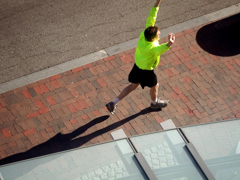 Runner with arms overhead